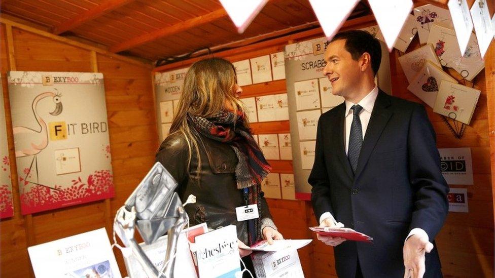 George Osborne with stall retailer at a Christmas Fair