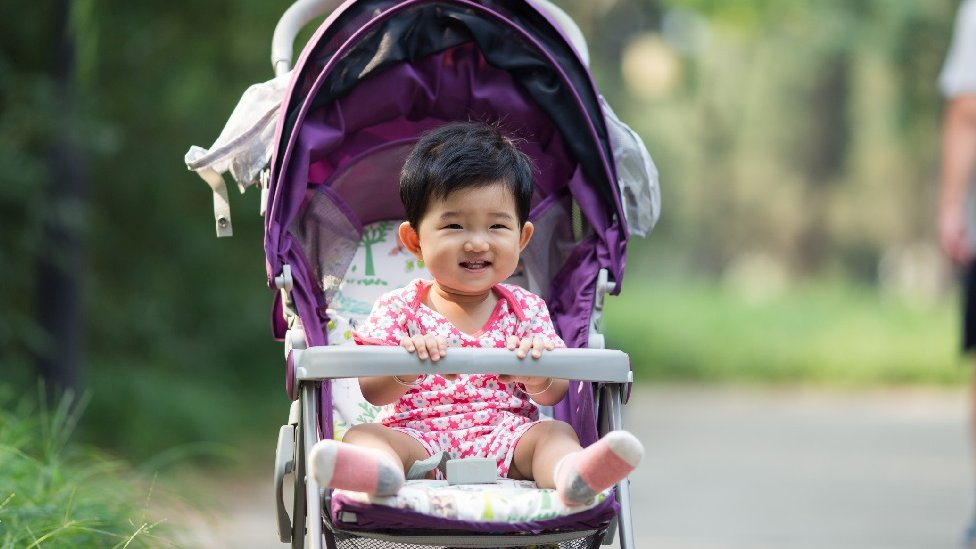 A baby in a pushchair in China