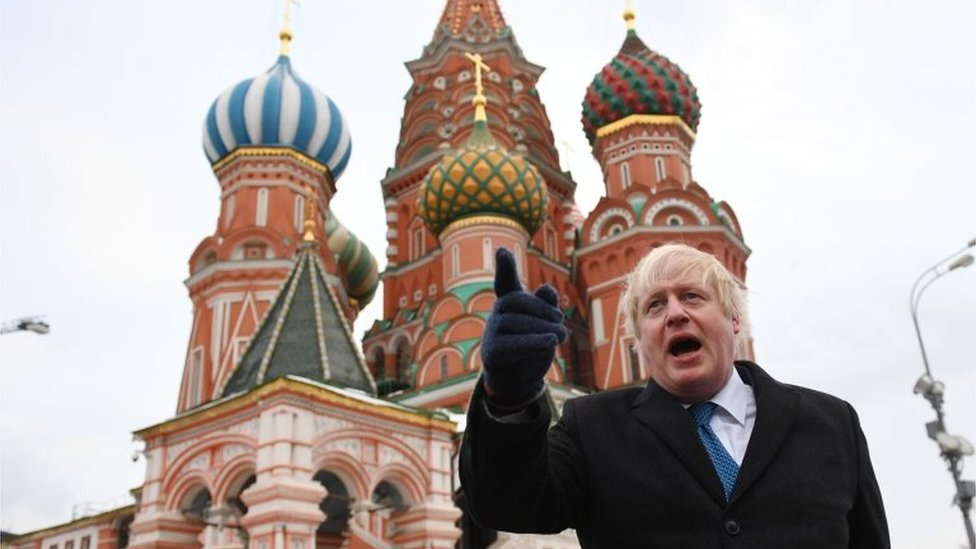 "Boris Johnson stands in front of Saint Basil""s cathedral in Red square in Moscow"