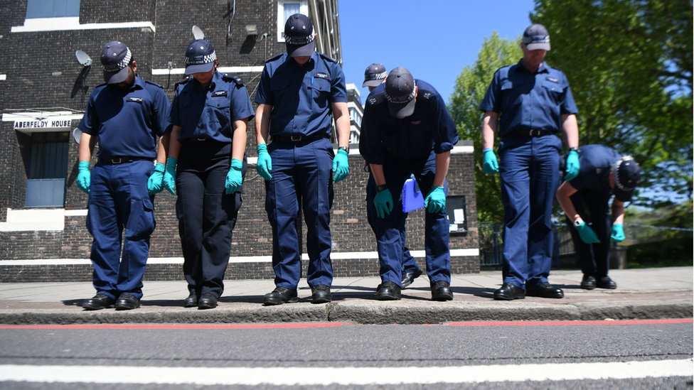 A police search team at the scene outside Aberfeldy House in Camberwell New Road