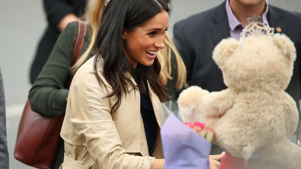The Duchess of Sussex receiving a Teddy bear