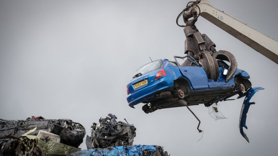 Car being scrapped
