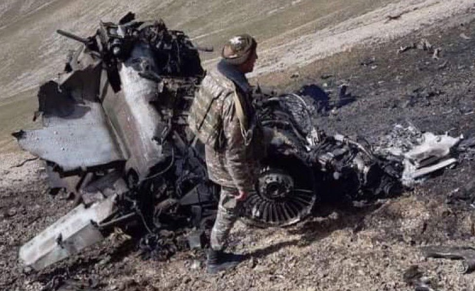 Armenia's defence ministry has published photos of an SU-25 jet it claims was shot down by a Turkish warplane