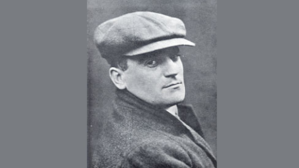 A portrait picture of Hugh Blaker wearing a hat