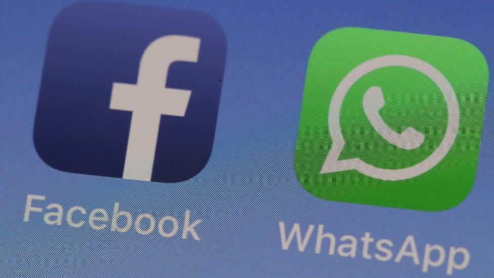 WhatsApp and Facebook logos on a phone