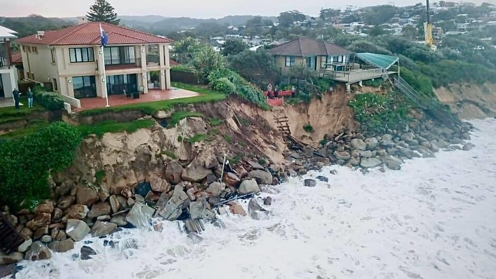 Houses along Warambel Beach which has been wiped away due to the surg