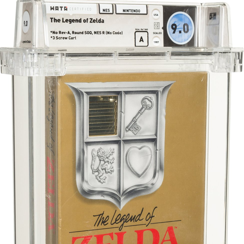 The gold Legend of Zelda cartridge box