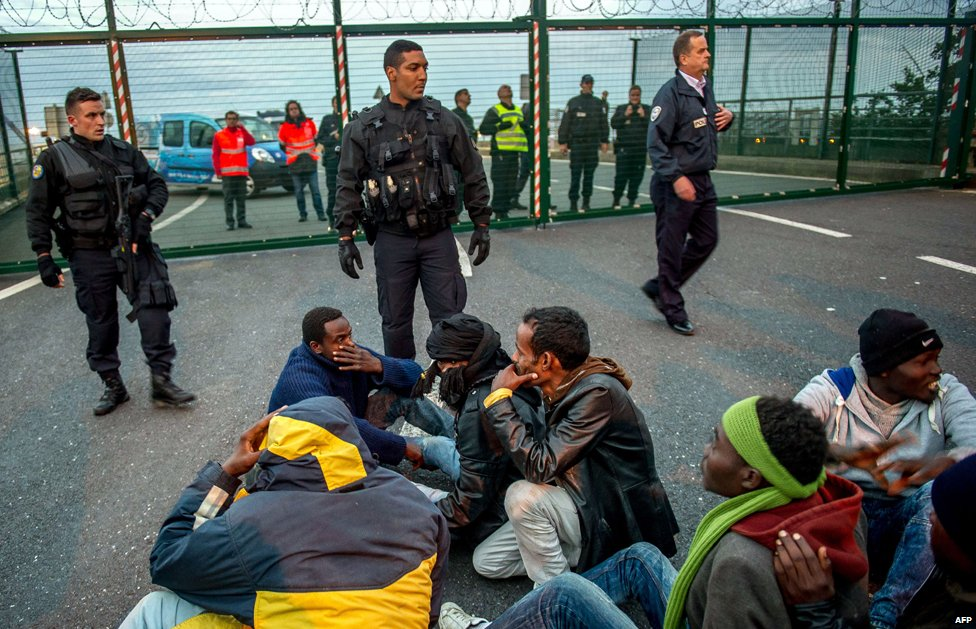 Migrants outside the Eurotunnel gates