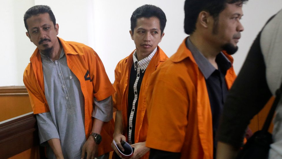 Suspected militants, from left, Abdul Hakim, Ahmad Junaedi and Tuah Febriwansyah, who is also known as Fachry, attend trial at West Jakarta District Court in Jakarta, Indonesia, Monday, Oct. 12, 2015