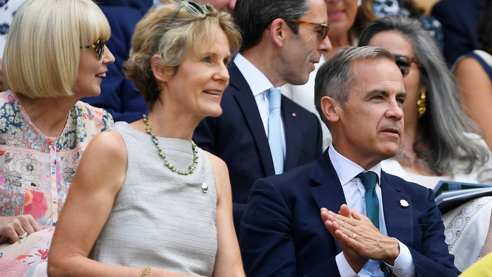 Mark Carney and his wife Diana Fox attend a match at Wimbledon in July