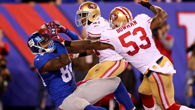 Larry Donnell makes a fingertip catch