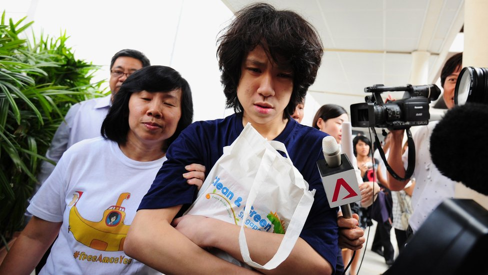 Singapore blogger Amos Yee, accompanied by his mother, outside a court in Singapore, 6 July 2015