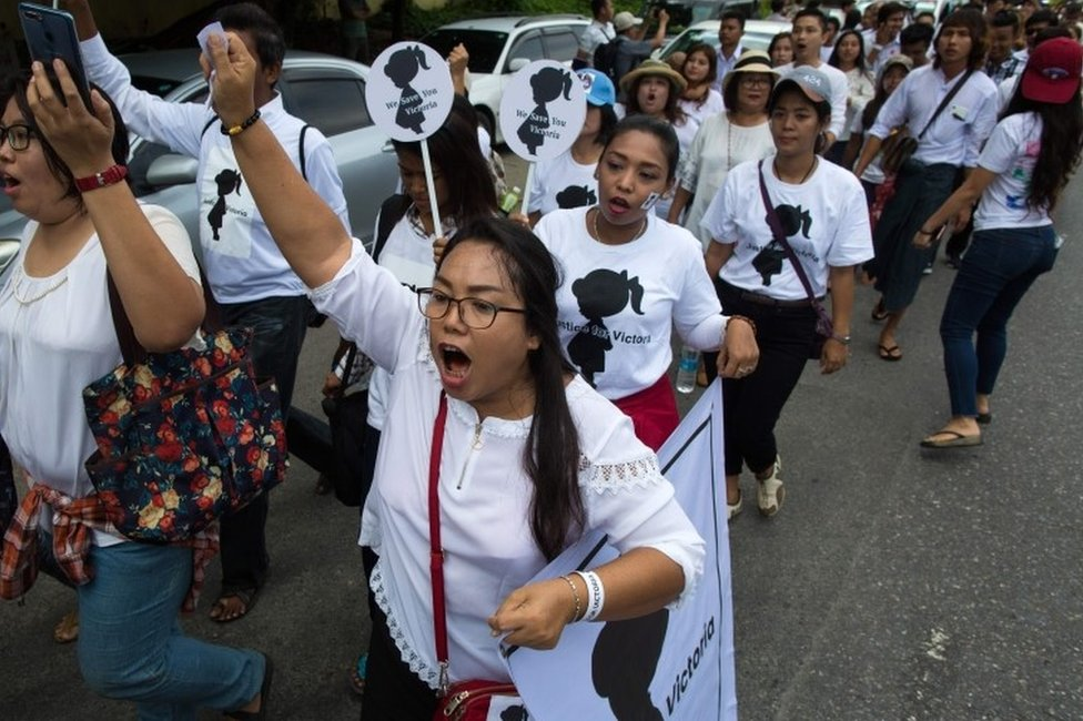 """Protesters walk to the Central Investigation Department (CID) during the demonstration demanding justice for a two-year-old who was raped and given the pseudonym """"Victoria"""" in Yangon on July 6, 2019."""
