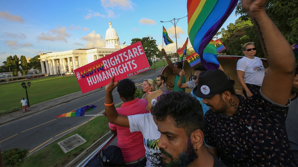 "A Sri Lankan man holds a placard which states "" LGBTIQ rights are human rights' at Colombo, Sri Lanka on Saturday 17 June 2017"