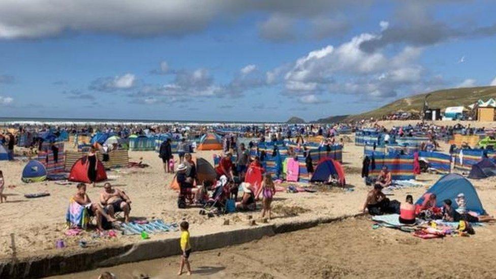Perranporth beach in Cornwall full with beach-goers