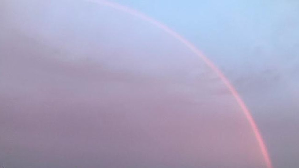 Pink rainbow over Dorchester, Dorset