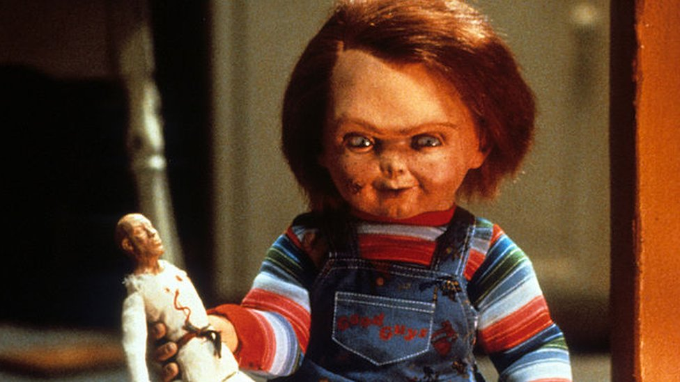 Chucky with doll in a scene from the film 'Child's Play', 1988
