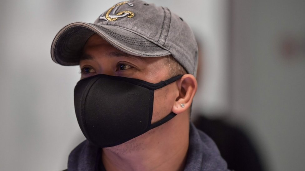 A man wears a mask in Guarulhos International Airport, in Guarulhos, Sao Paulo, Brazil