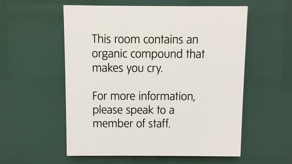 A sign reading: This room contains an organic compound that makes you cry. For more information please speak to a member of staff