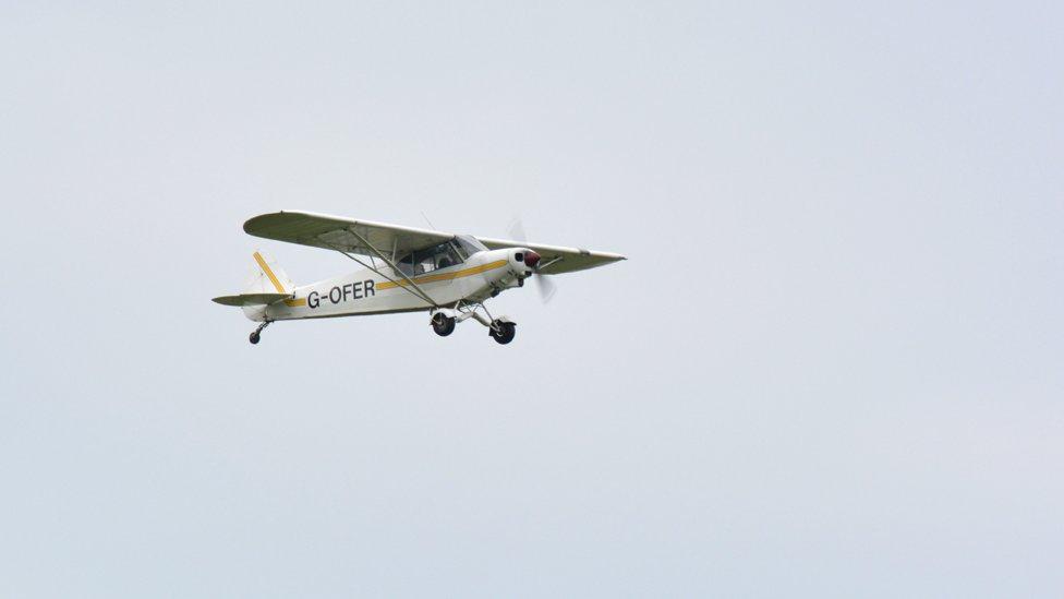Mollie's plane taking off