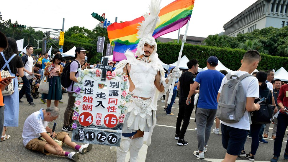 People take part in a rally in support of same-sex marriage near the Presidential Office in Taipei on November 18, 2018, ahead of a landmark vote on LGBT rights on November 24.
