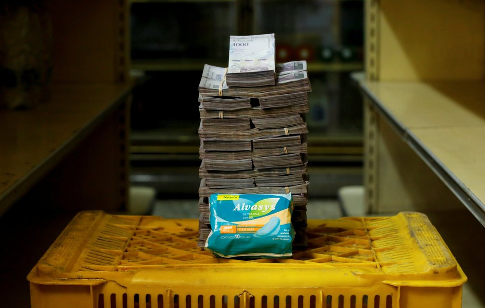 A packet of sanitary pads next to 3,500,000 bolivars