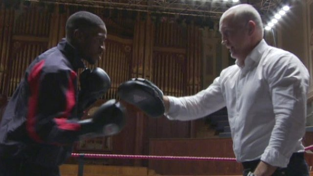 A young Washington boxer trains with Barry McGuigan at the Ulster Hall in Belfast