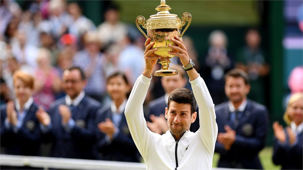 Novak Djokovic celebrates winning the Wimbledon men's singles title