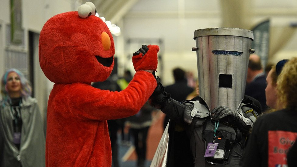 Elmo and Count Binface share a handshake