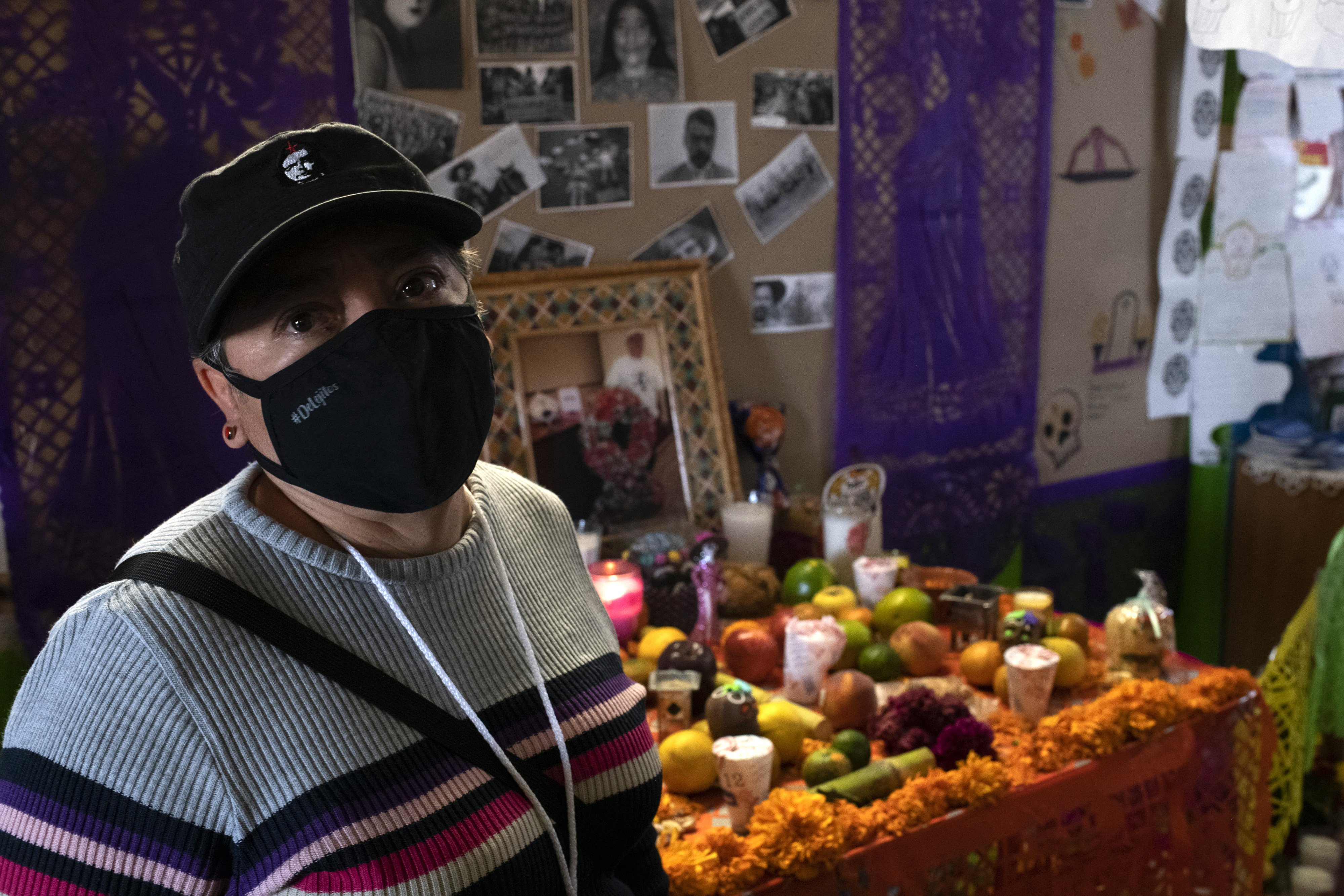 Elvira Madrid Romero in front of the offering for Jaime Alberto Montejo, who founded the organisation Brigada Callejera, which supports female sex workers
