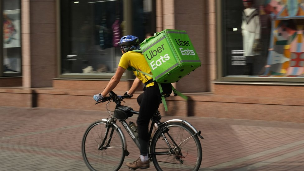 An Uber Eats food courier