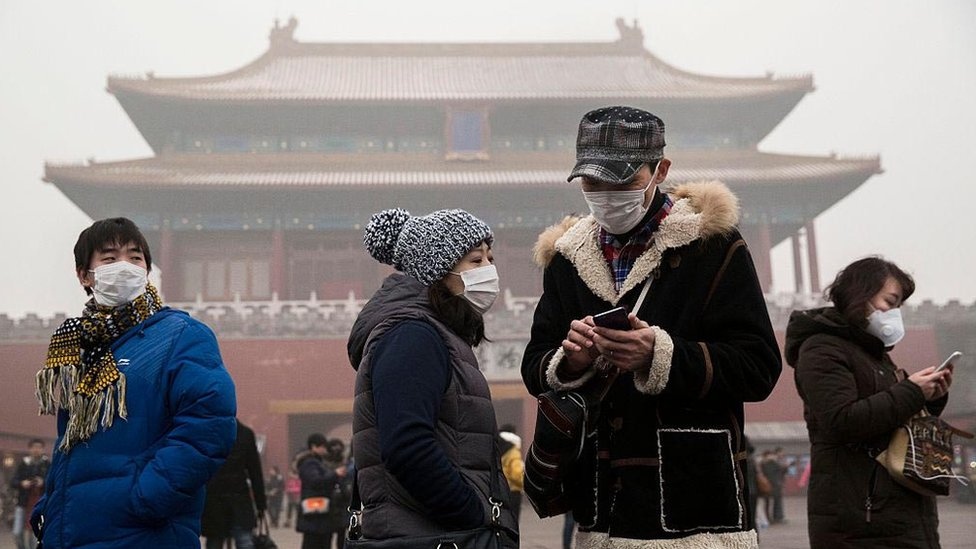 People wearing masks as protection from the pollution outside the Forbidden City