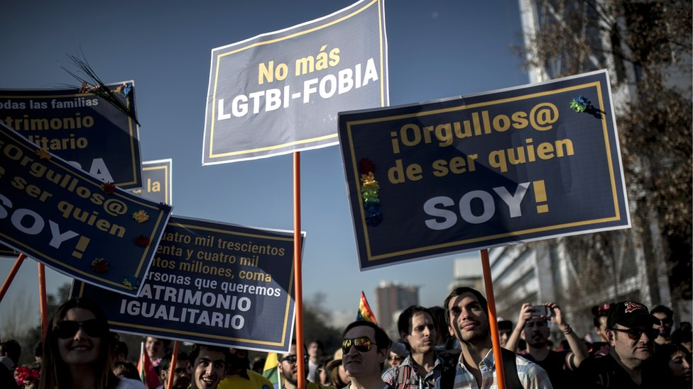 Activists take part in the Gay Pride Parade in Santiago on July 1, 2017.