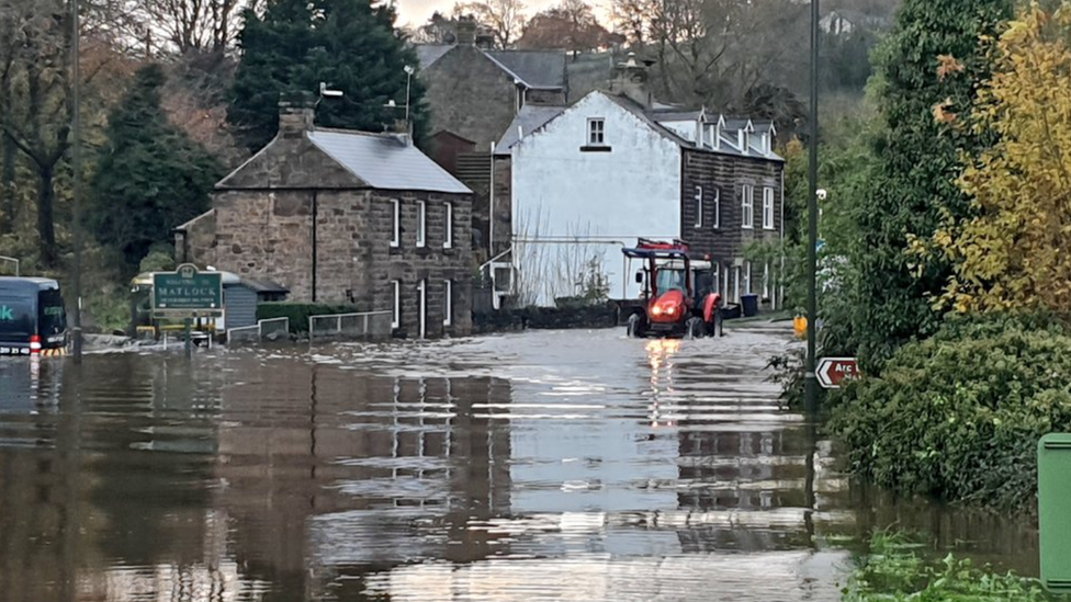 Tractor through flood water