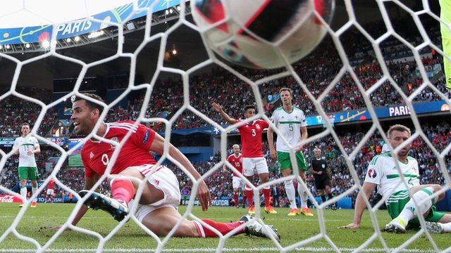 Gareth McAuley's touch sends the ball into his own net in the Euro 2016 defeat by Wales