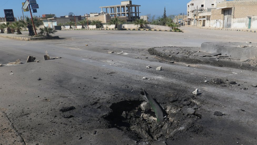 Crater in a road after a suspected chemical attack in Khan Sheikhoun, Idlib province, Syria (4 April 2017)