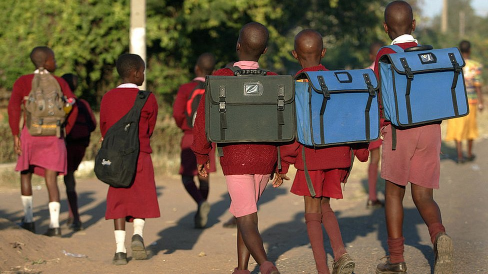 Zimbabwean students go to school on May 7, 2008 in Mbarae, Harare