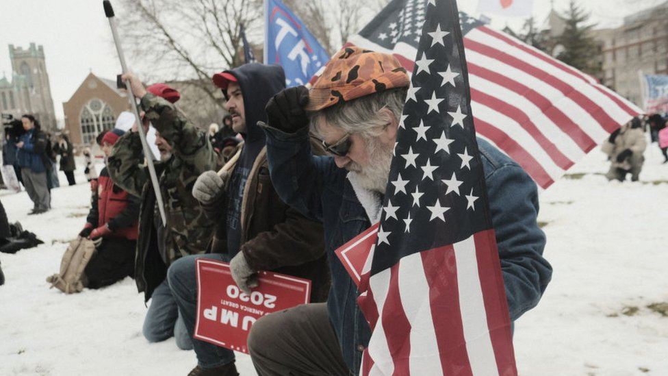Supporters of President Donald Trump join in a mass prayer out front of the Michigan State Capitol Building to protest the certification of Joe Biden as the next president on January 6, 2021