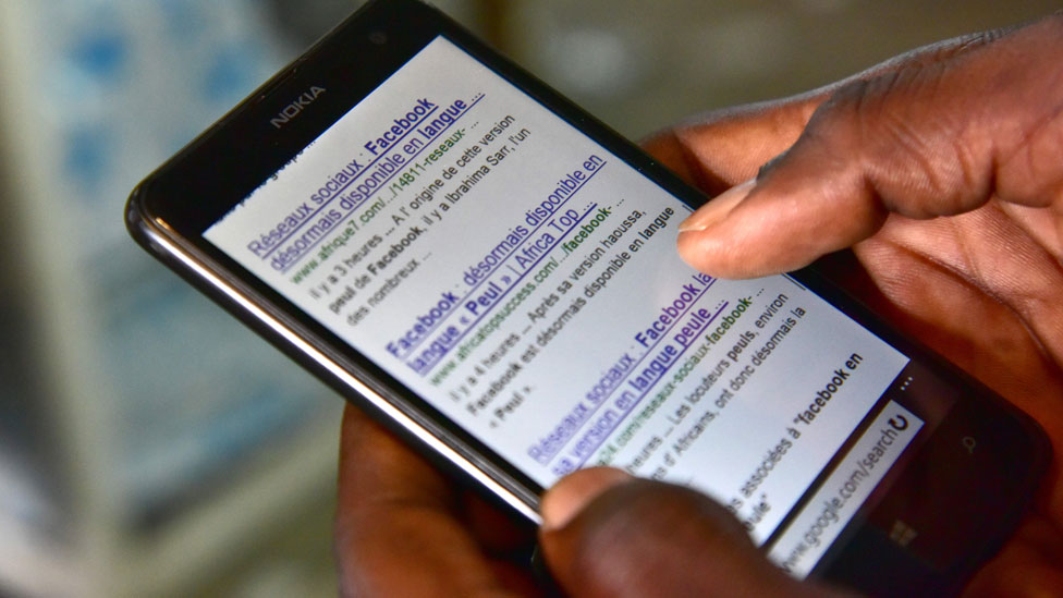 a hand scrolling through a smart phone