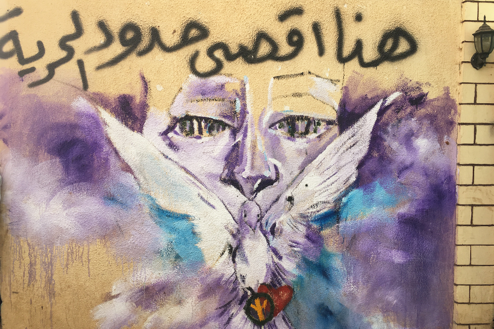 A mural featuring a dove by the entrance of the vocational training centre in Khartoum, Sudan