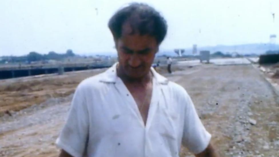 Man looks at ladybird on his shirt
