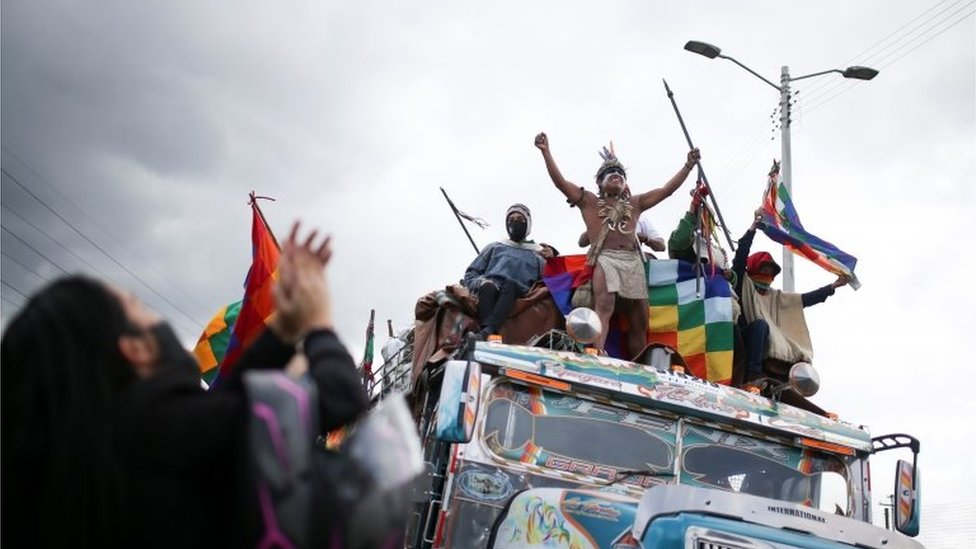 "Colombian indigenous people travel on a bus to participate in a protest to ask the Colombian government for security in their territories and to stop massacres and murders of social leaders, during an indigenous meeting called ""Minga"" in Cundinamarca, Colombia October 18, 2020"