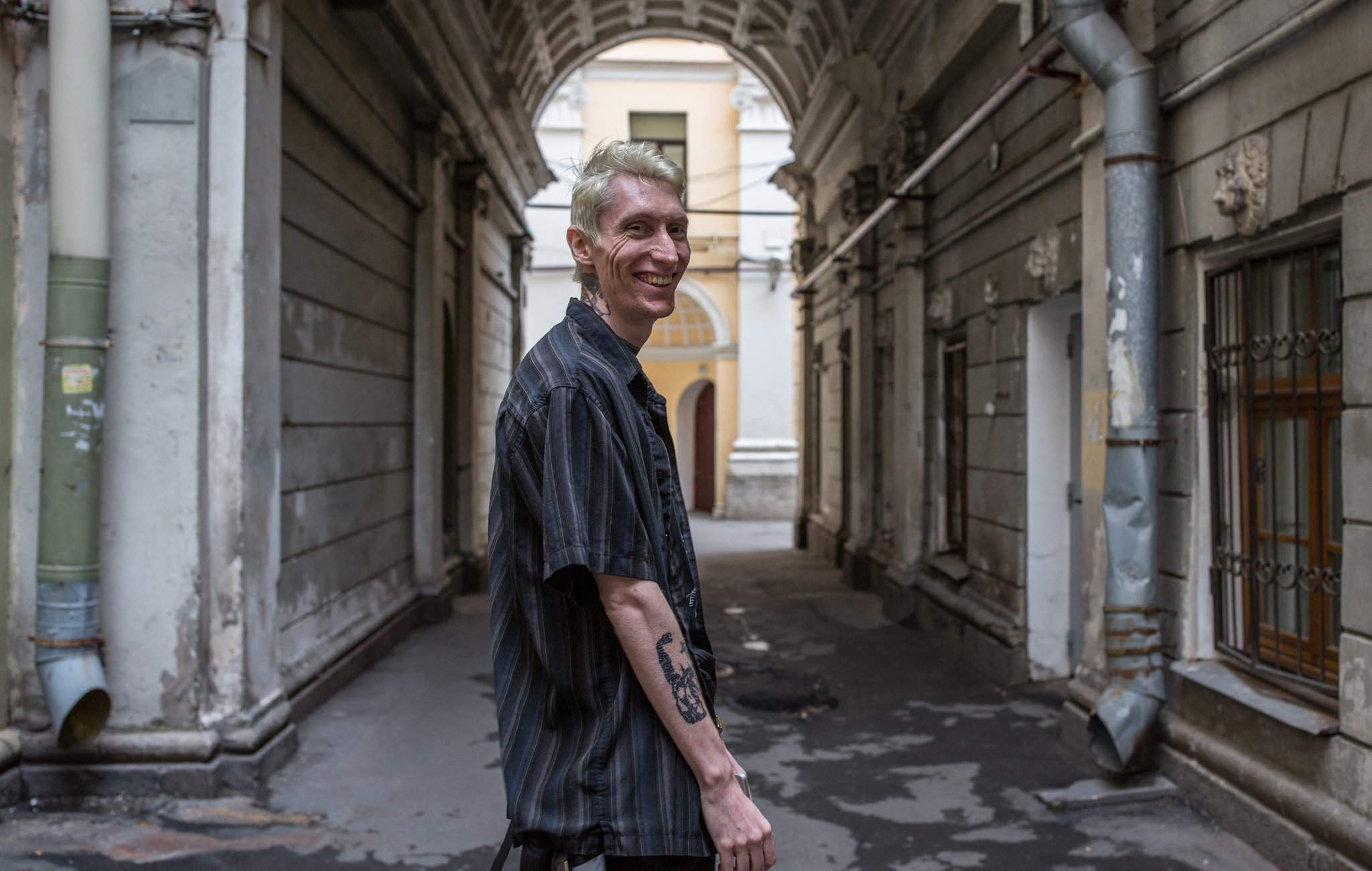 Kostya smiling beneath an archway