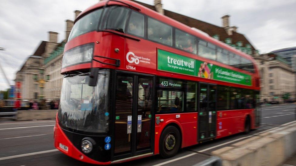 Red bus crossing Waterloo bridge, London
