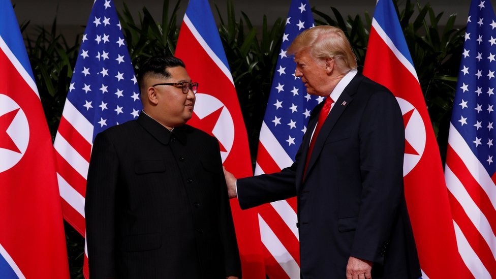 "U.S. President Donald Trump and North Korea""s leader Kim Jong Un meet at the Capella Hotel on the resort island of Sentosa, Singapore"