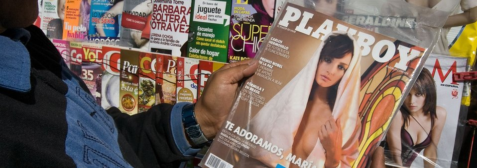 A man looks at a Playboy magazine in Mexico City