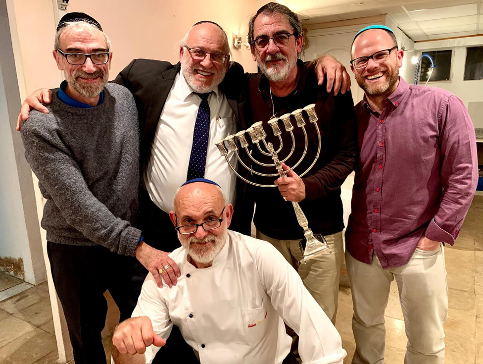 Dani, right, and Toni (in chef's jacket) with other members of the Jewish community