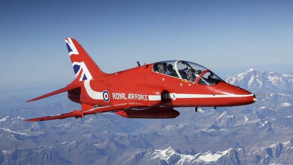 Red Arrows jet flying over the Alps