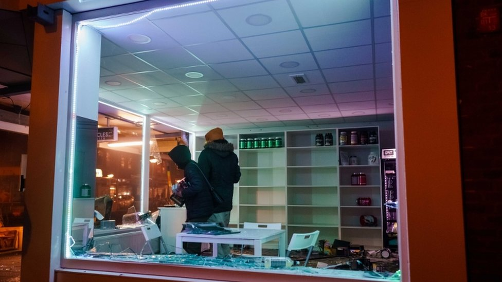Looting in a shop after a large group of young people clashed police on the Beijerlandselaan in Rotterdam, The Netherlands
