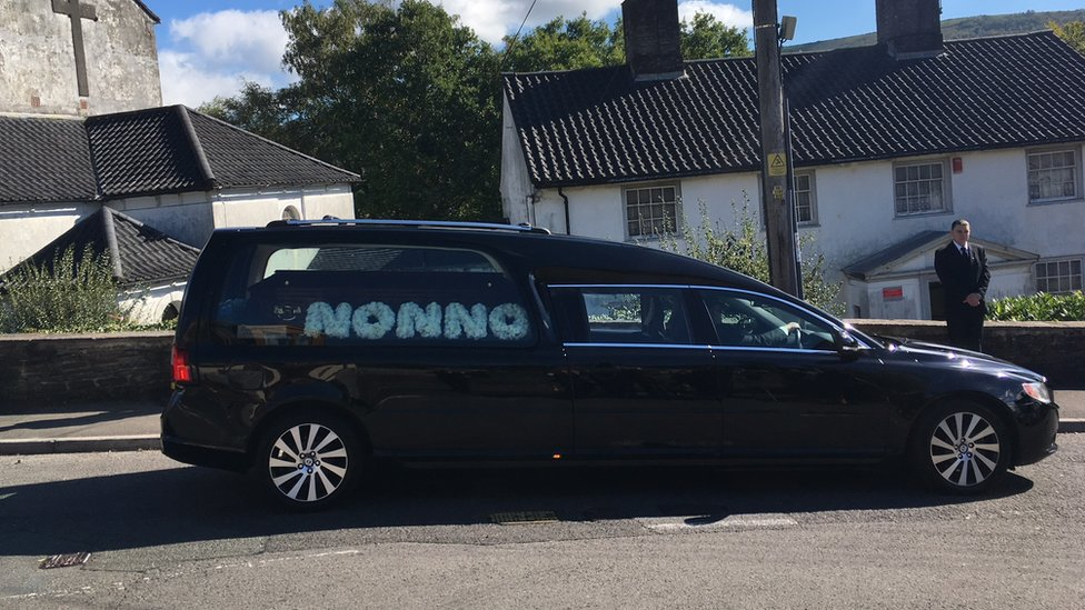 The hearse carrying Enzo Calzaghe's body with the word Nonno, Italian for Grandpa, written in white flowers